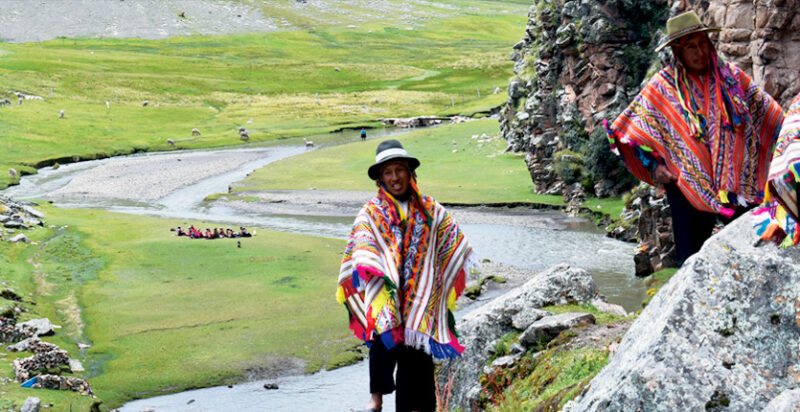 Trekker dressed in traditional Peruvian clothing on the way to Ananiso Canyon