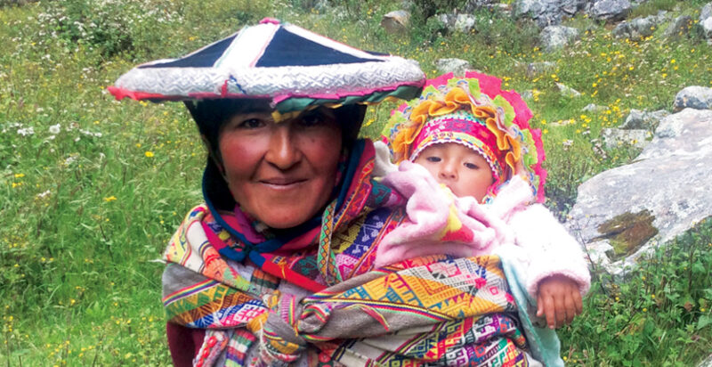 Mother and child dressed in traditional Peruvian clothing