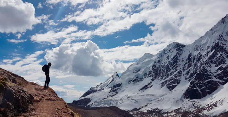 A trekker admiring the Ausangate Mountain