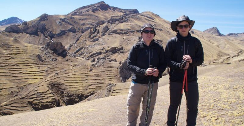 Two Smiling Trekkers standing in front of a Peruvian Mountain