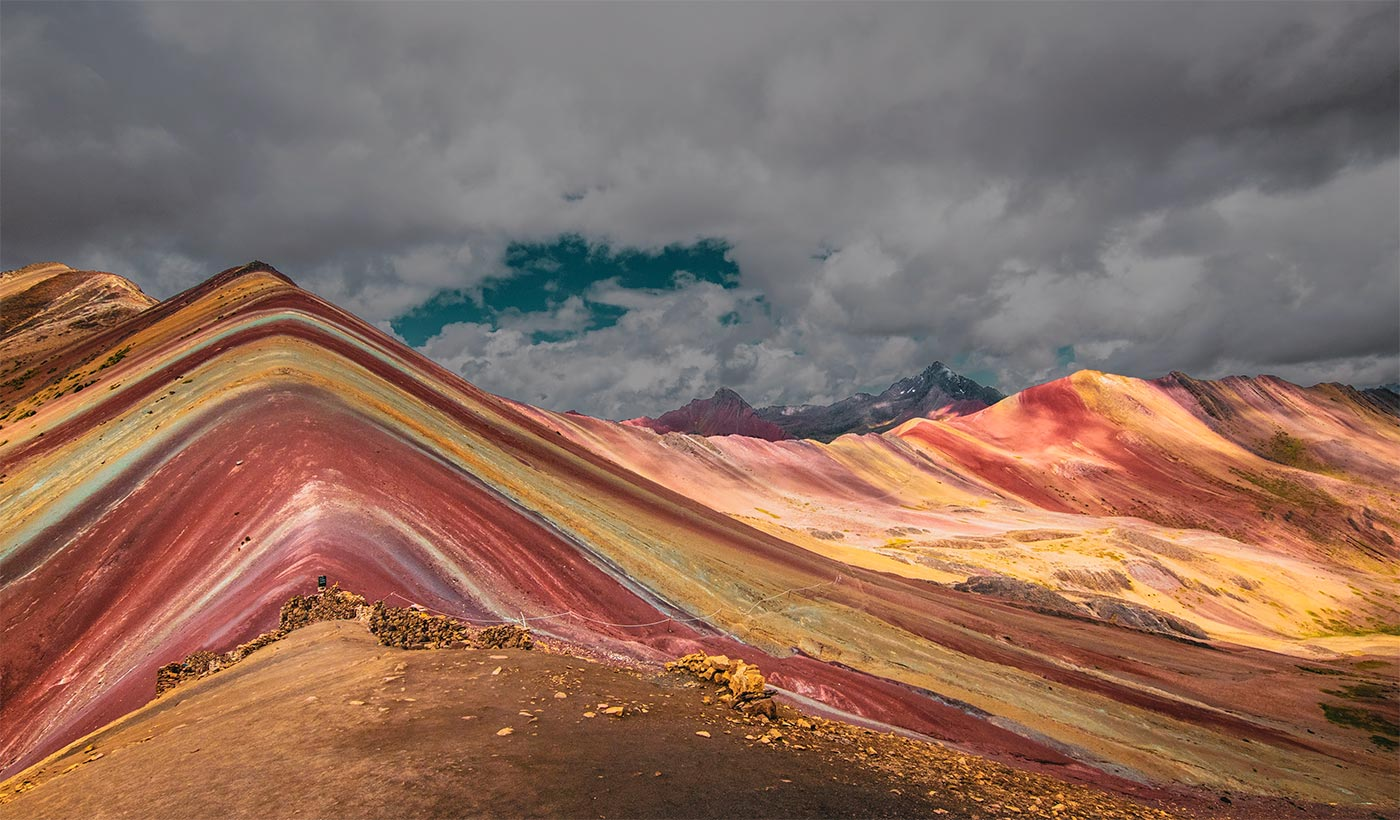 Rainbow Coloured Mountains in Cusco on a cloudy day